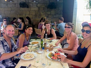 English students enjoying a meal in a restaurant