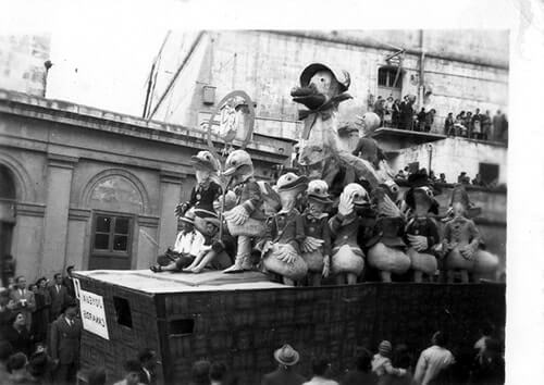 An old black and white photo of a carnival float in Valletta