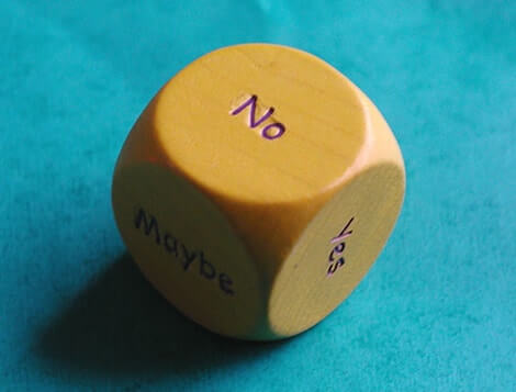 "a dice with ""no"" written on one side"
