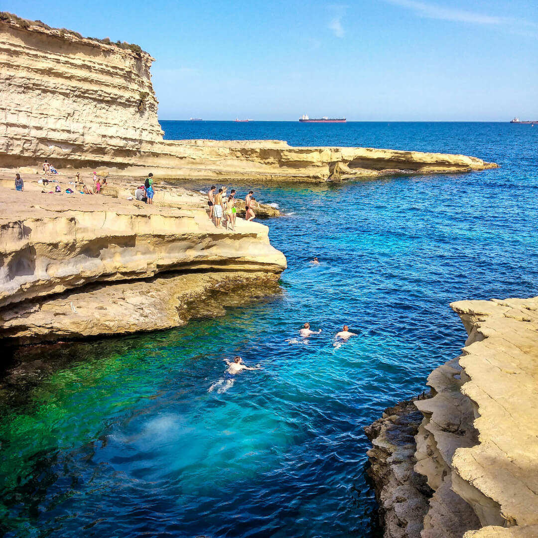 People swimming in Malta in March.