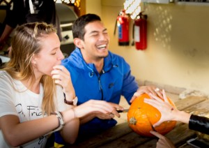 Having fun while carving Halloween pumpkins